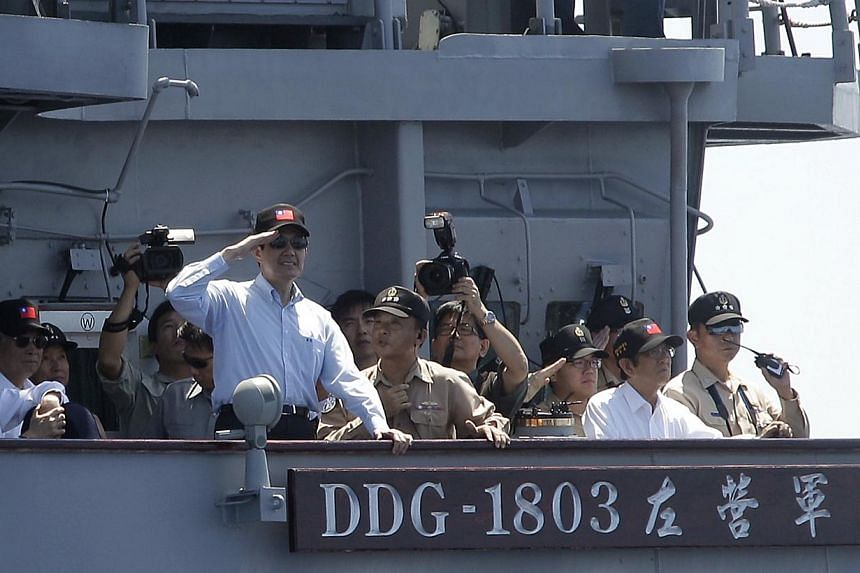 Taiwan's President Ma Ying-jeou salutes navy officers on a Kidd-class destroyer during a military exercise. Taiwan is considering stationing armed vessels permanently on a disputed South China Sea island, officials said. -- PHOTO: REUTERS