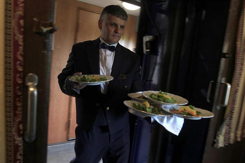 Lunch is served aboard a historic Tehran-bound train as it leaves Budapest October 15, 2014. -- PHOTO: REUTERS