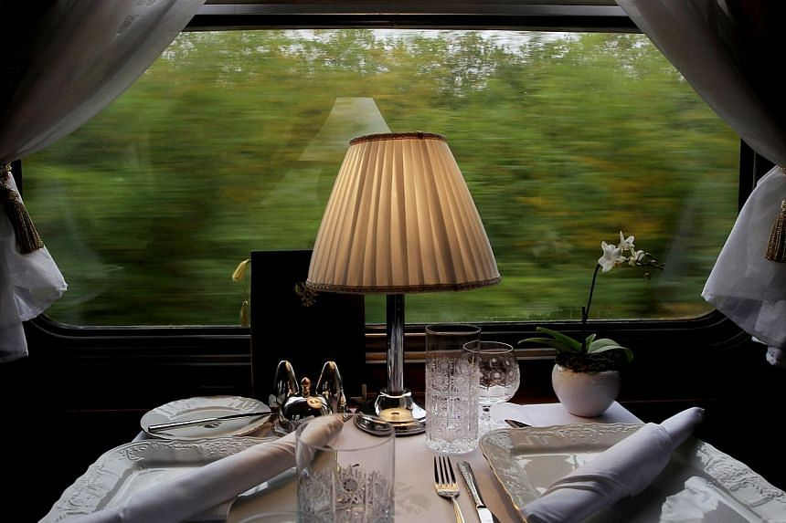 A table set for lunch is seen aboard a historic Tehran-bound train as it leaves Budapest October 15, 2014. -- PHOTO: REUTERS