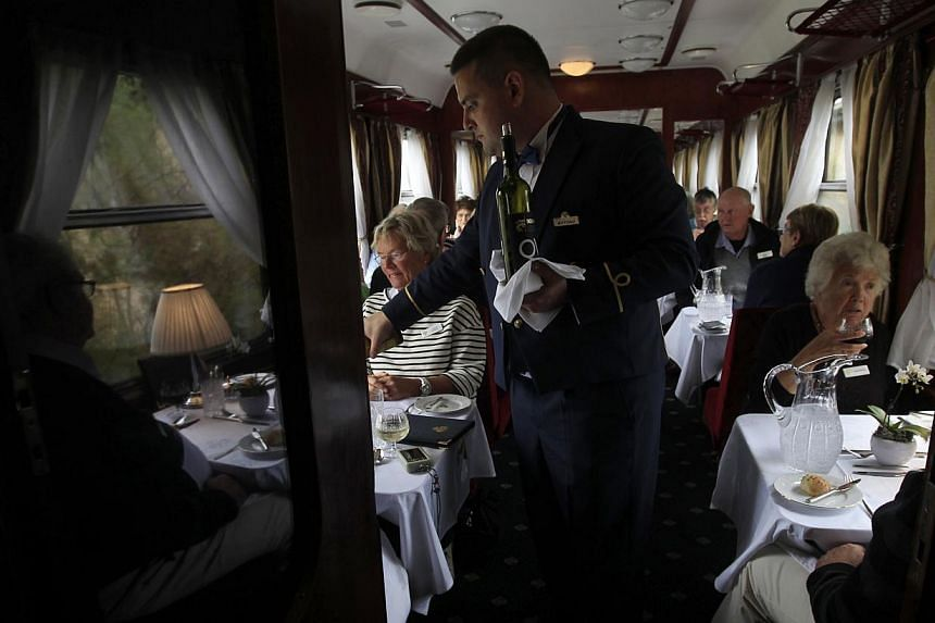 Lunch is served aboard a historic Tehran-bound train as it leaves Budapest October 15, 2014. The train, a set of luxury cars retrofitted from historic models to reflect times gone by, will take two weeks to wind through the 7,000km journey across the