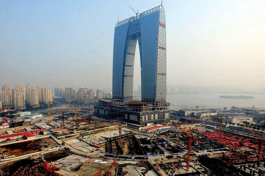 This picture taken on May 1, 2014 shows the 301.8-meter arch-shaped building which will house 69 stores, a luxury hotel, offices and shopping mall in Suzhou, eastern China's Jiangsu province. -- PHOTO: AFP
