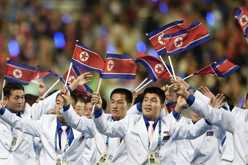 North Korean athletes wave their national flag as they parade during the closing ceremony of the 2014 Asian Games at The Incheon Asiad Main Stadium in Incheon on Oct 4, 2014.South Korea said on Thursday that it would pay more than 70 per cent o