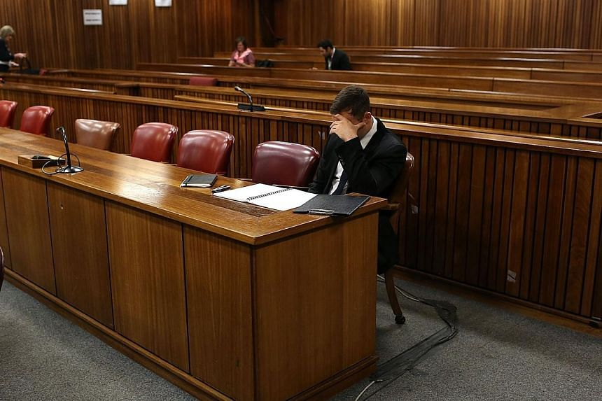 South African paralympic athlete Oscar Pistorius waits on Oct 16, 2014 before his sentencing hearing at the North Gauteng High Court in Pretoria, over the killing of Reeva Steenkamp.A cousin of Steenkamp made a tearful plea Thursday for Pistori