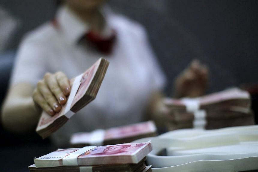 Chinese banks made 857.2 billion yuan (S$177.85 billion) worth of new loans in September, data showed on Thursday, beating market expectations in a sign that demand for credit is picking up. -- PHOTO: REUTERS
