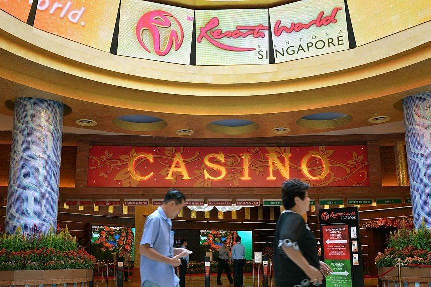 Shares in casino operator Genting Singapore, which operates Resorts World Sentosa, fell 2.8 per cent on Thursday after weakness in the high-rollers' business at rival Marina Bay Sands (MBS) stoked worries of poor results at the gaming firm. -- PHOTO: