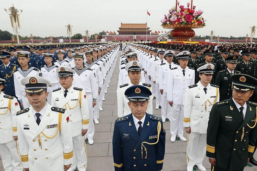 China will toughen audits of its military and target older officers to ensure that corrupt individuals are denied promotion and cannot get away with their crimes, the Defence Ministry said on Thursday. -- PHOTO: AFP