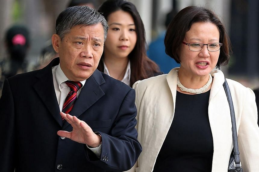 Aljunied-Hougang-Punggol East Town Council (AHPETC) chairman Sylvia Lim arriving at the State Courts with her lawyer Peter Lowon Thursday.The trial to decide if the Workers' Party town council flouted the law in holding an unlicensed Chin