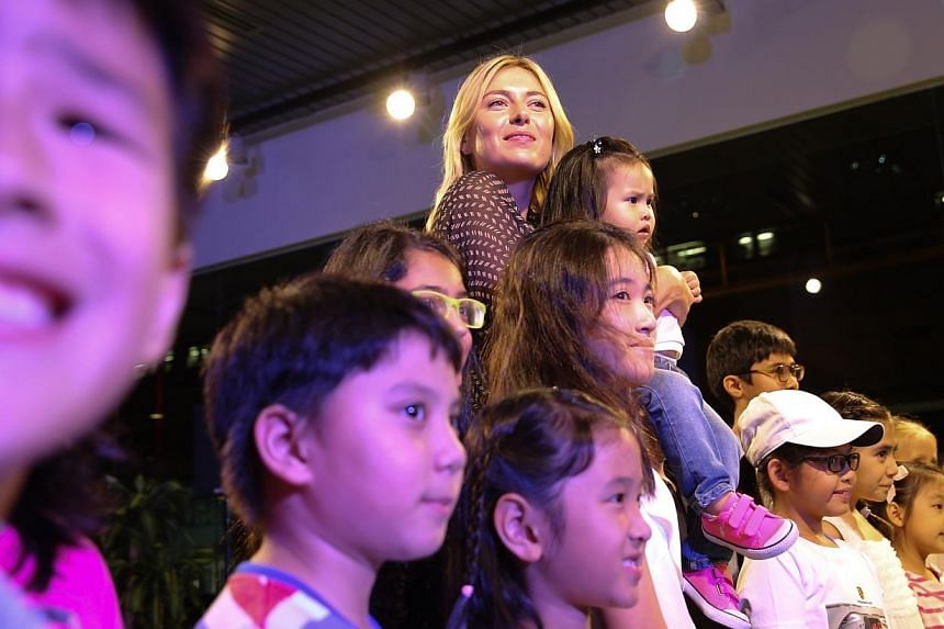 Maria Sharapova at an auction to raise funds for Straits Times Pocket Money Fund at the Porsche showroom. -- ST PHOTO: ONG WEE JIN