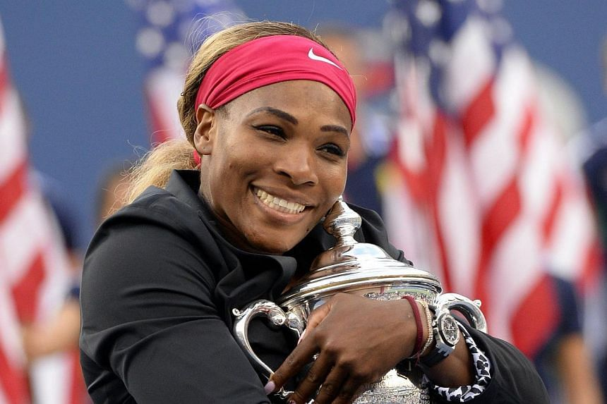 Serena Williams of the US holds the US Open trophy after defeating Caroline Wozniacki of Denmark during their US Open 2014 women's singles finals match at the USTA Billie Jean King National Center on Sept 7, 2014 in New York.Williams arrived in