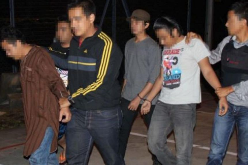 Police have arrested 14 suspected militants, including three key figures believed to be behind the recruitment of Malaysians into the Islamic State in Iraq and Syria (ISIS). -- PHOTO: THE STAR/ASIA NEWS NETWORK