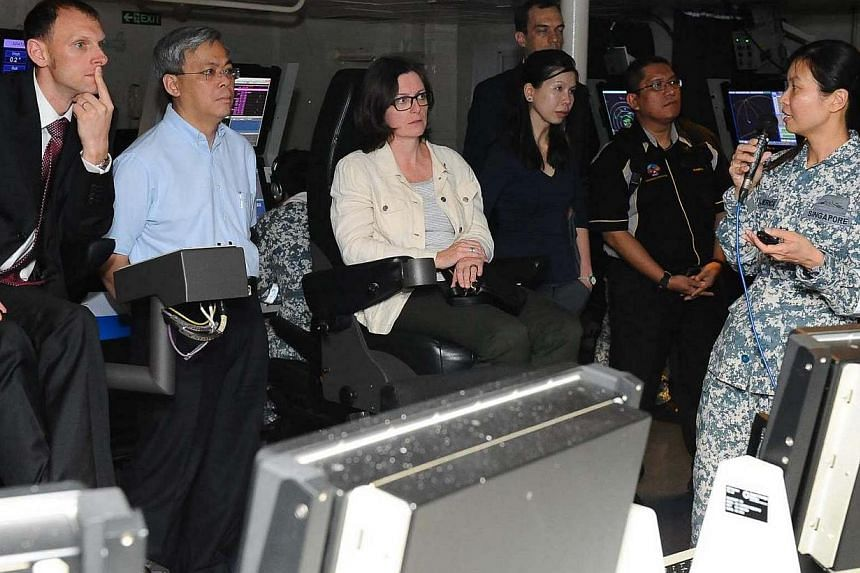 Permanent Secretary for Defence Mr Chan Yeng Kit (second from left) and senior officials of the FPDA member nations being briefed on board RSS Formidable during Ex Bersama Lima.-- PHOTO: MINISTRY OF DEFENCE