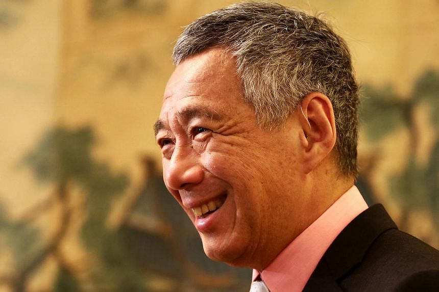 Prime Minister Lee Hsien Loong at a media conference after wrapping up an eight-day official visit to southern China and Hong Kong. -- PHOTO: ZAOBAO FILE