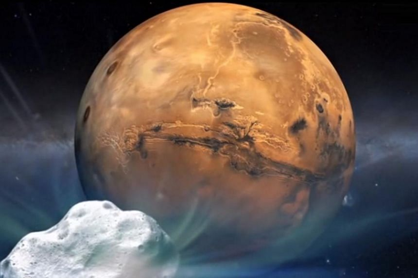 This artist's concept illustration provided by NASA depicts the Comet Siding Spring and Mars. On Oct 19, Comet Sliding Spring, a comet that has travelled many billions of miles, will come within about 87,000 miles of Mars, about one-third of the dist