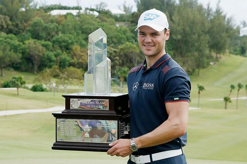 Martin Kaymer of Germany poses with the trophy after winning the PGA Grand Slam of Golf at Port Royal Golf Course on Oct 15, 2014 in Southampton, Bermuda. -- PHOTO: AFP