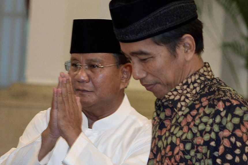 Indonesia's losing presidential candidate Prabowo Subianto (left) said on Friday his party would support President-elect Joko Widodo (right), but would not hesitate to criticise any of his policies that they opposed. -- PHOTO: AFP