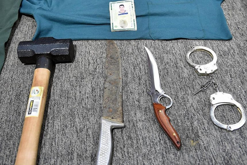 Picture of objects seized during the arrest, on the eve, of alleged serial killer Thiago Henrique Gomes da Rocha, suspected of killing 39 people, at the Department of Security in Goiania, state of Goias, Brazil, on Oct 16, 2014. -- PHOTO: AFP