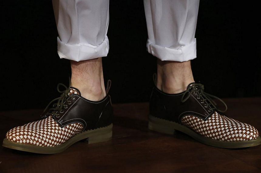 Jimmy Choo inched higher on its London stock market debut, watched closely by even the least fashion-conscious of bankers after a flurry of cancelled listings across Europe. -- PHOTO: REUTERS