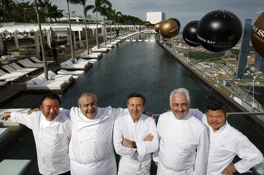 Celebrity chefs (from left), Tetsuya Wakuda, Santi Santamaria, Daniel Boulud, Guy Savoy and Justin Quek at the Skypark of Marina Bay Sands integrated resort, which was officially opened on June 23, 2010. -- ST PHOTO: KEVIN LIM