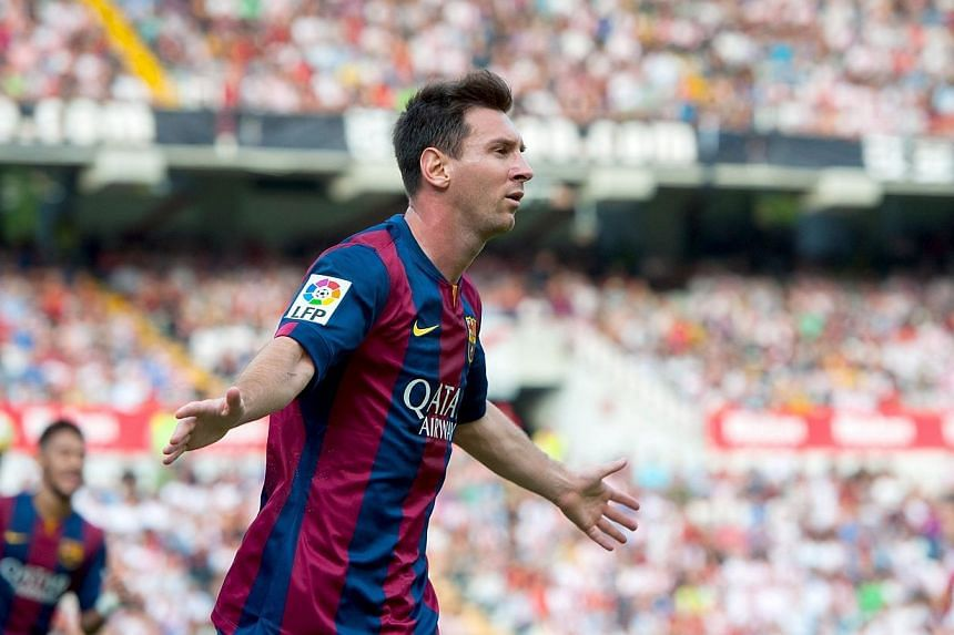 Barcelona's Argentinian forward Lionel Messi celebrates after scoring against Rayo Vallecano at the Vallecas stadium in Madrid on Oct 4, 2014. -- PHOTO: AFP