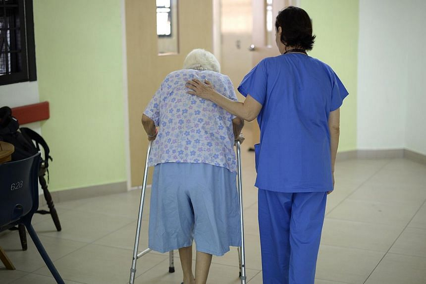 A nurse helping an elderly patient at Institute of Mental Health. When it comes to identifying and taking care of mental health patients, everyone- from friends and family, to grassroots workers and general practitioners - must play a part, says Heal