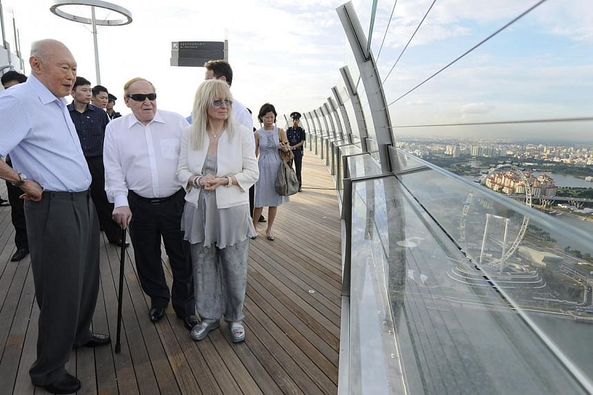 Minister Mentor Lee Kuan Yew taking in the view from Marina Bay Sands' Sky Park Observation Deck during his visit to the integrated resort on 22 June 2010, the eve of its official opening. With him are Mr Sheldon Adelson, president and chief execut