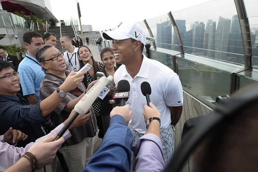 American golfer Tiger Woods speaking during a question and answer session with the media against the backdrop of the central business district skyline at the Marina Bay Sands Skypark in Singapore on Nov 3, 2011. -- PHOTO: ST FILE