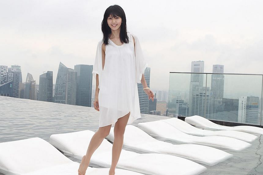 Home-grown singer Stefanie Sun in a photograph taken at the infinity pool in the SkyPark of Marina Bay Sands. -- PHOTO: WONDERFUL MUSIC