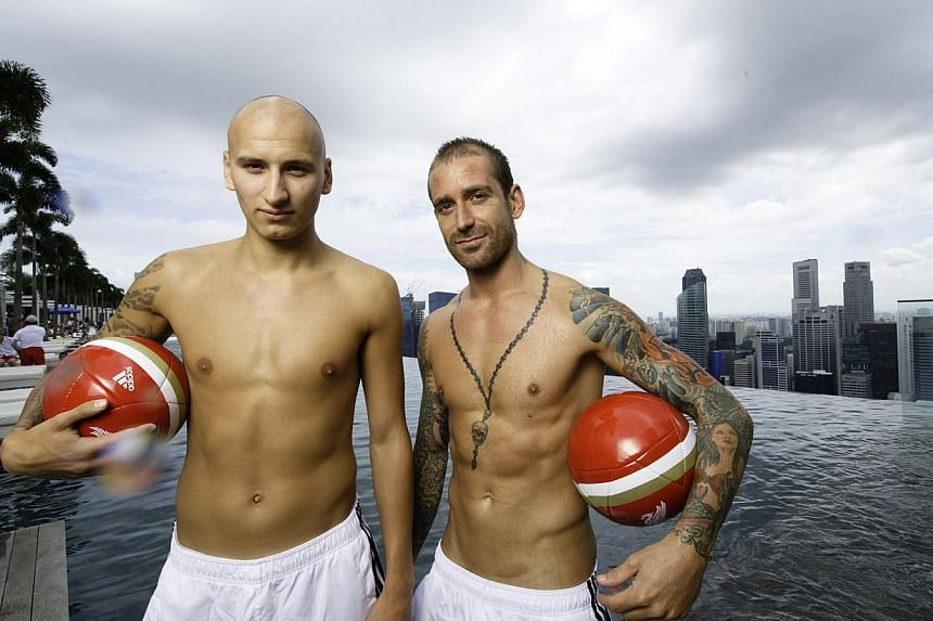 Then Liverpool players Raul Meireles and Jonjo Shelvey in a photograph taken at the infinity pool in the SkyPark of Marina Bay Sands. -- PHOTO: MBS