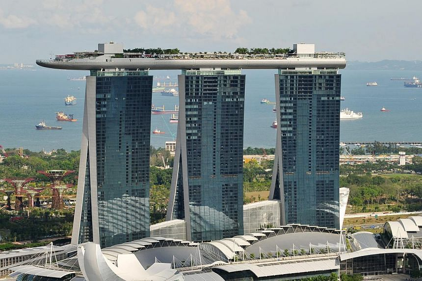 Marina Bay Sands posted profits of US$351.7 million for the third quarter ended Sept 30 as revenue from casino operations slowed due to weakness in the high-roller business. -- PHOTO: ST FILE