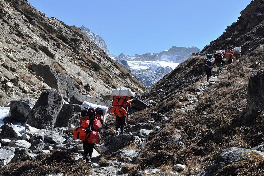 People trekking along the Forbidden Valley in Nepal in 2013. Singapore tour agencies say upcoming treks in Nepal will proceed as planned, following a snowstorm that ripped through the Himalayan region. -- PHOTO:BLACK TOMATO