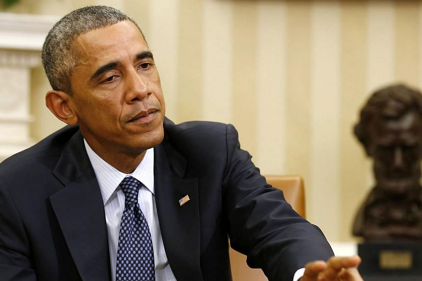 """United States President Barack Obama said he was considering appointing an Ebola """"czar"""" to coordinate the fight against the virus in the US, but he remained opposed to a ban on travel from West Africa. -- PHOTO: REUTERS"""