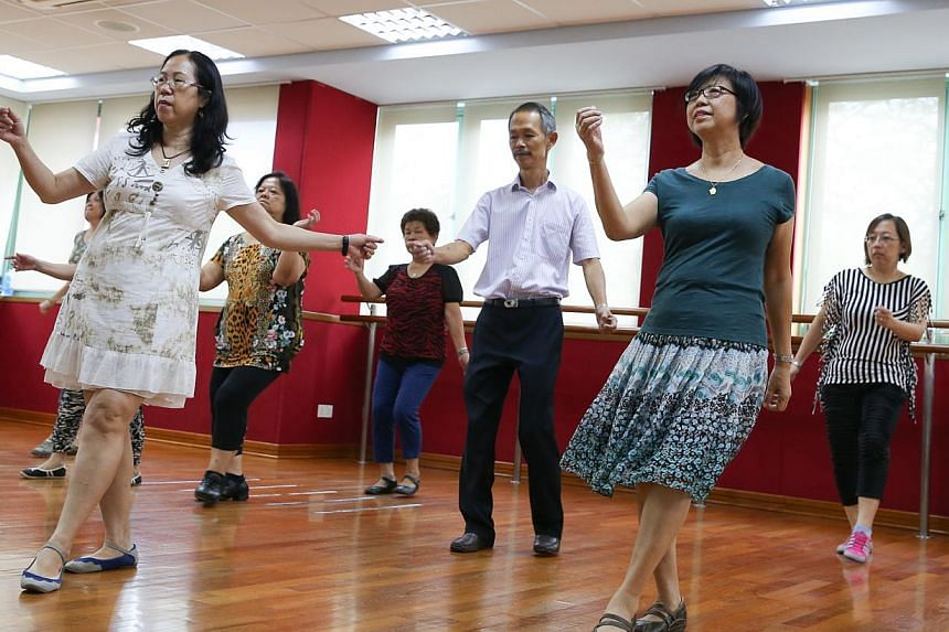 Participants at a folk dance class at a community centre. To help spread the message of life-long learning among Singaporeans, the Lifelong Learning Council has been set up by the Singapore Workforce Development Agency. -- ST PHOTO: