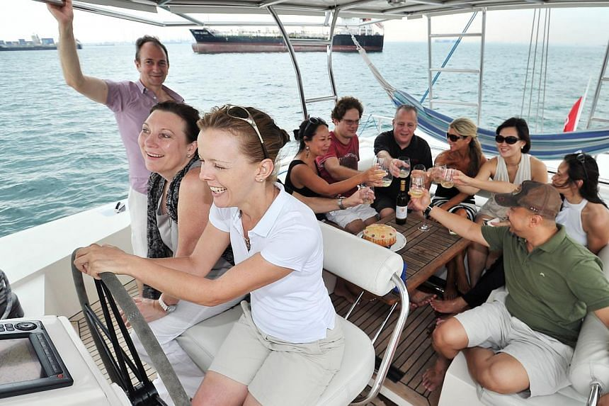Wine and dine against a sunset with Blue Star Yachting's Sunset Cruise. -- PHOTO: LIM YAOHUI FOR THE STRAITS TIMES