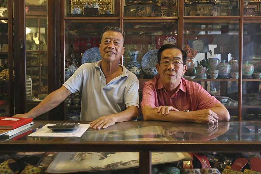 """Guan Antique's Mr Ng Ah Choon (left) - with co-owner Chua Chye Hong - said the people patronising the shops in the area are getting younger, with """"most coming here to eat or for coffee""""."""
