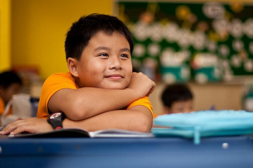 Despite having to spend close to 11 hours at Nan Hua Primary each schoolday, 10-year-old Vincent Qi has no complaints about the in-house after-school care arrangement. The Primary 4 pupil gets to play board games or soccer with his close friends in t