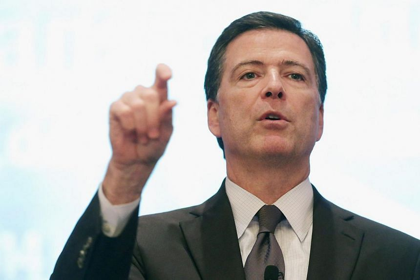 US FBI director James Comey (seen here, above, in September) on Thursday made his strongest comments yet about encryption features built into new cellphones by Google and Apple, warning they could hurt law enforcement efforts to crack homicide and ch