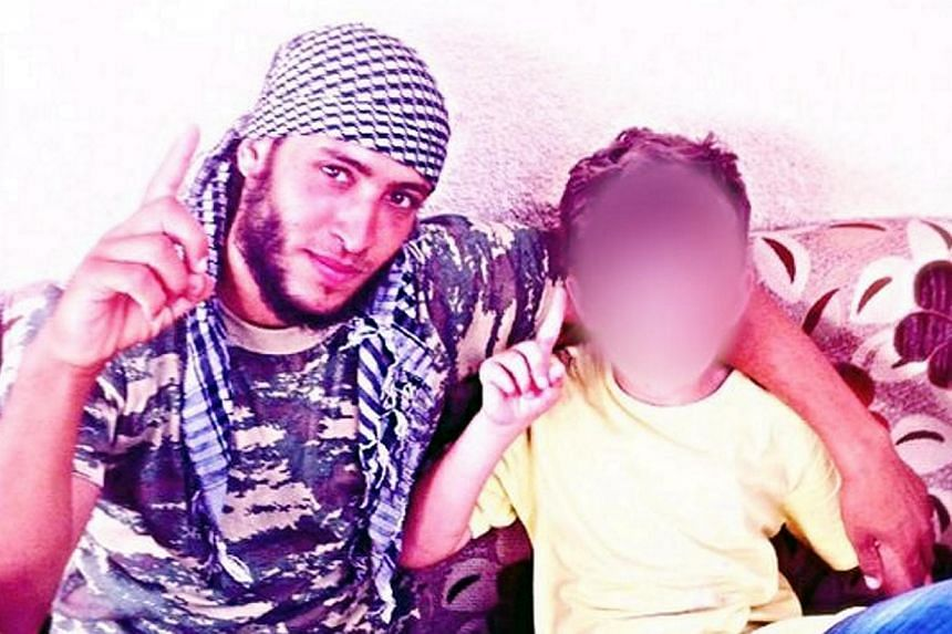 A picture of Erion Abazi (right) in Syria on social media with an unidentified man. The eight-year-old Kosovo boy, taken to Syria five months ago by his father who joined militants there, has been brought home after an intelligence operation, officia