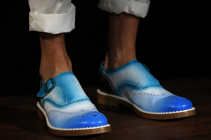 A model presents a creation from Jimmy Choo during its London Collections: Men show in London in this June 16, 2014 file photo. -- PHOTO: REUTERS