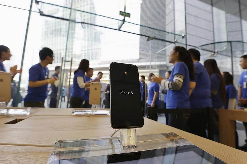 Sales staff welcoming the customers to buy iPhone 6 and iPhone 6 Plus at an Apple store in Beijing, on October 17, 2014. The iPhone 6 and iPhone 6 Plus will be available in the Chinese mainland from Friday, after rigorous regulator scrutiny led to Ap