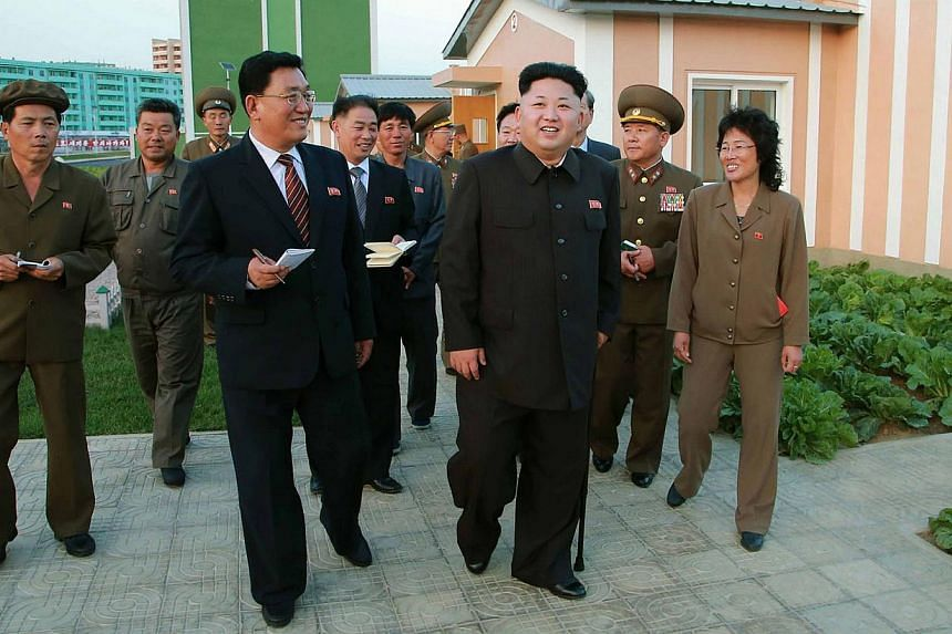 This undated picture released from North Korea's official Korean Central News Agency (KCNA) on October 14, 2014 shows North Korean leader Kim Jong Un smiling as he inspects a newly built housing complex in Pyongyang. Mr Kim has finally resurfaced wit