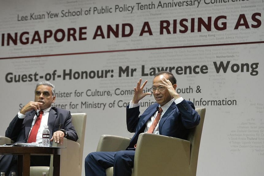 Former Minister George Yeo (right) holding a question and answer session moderated by LKYSPP dean Kishore Mahbubani after delivering his key note speech at the Lee Kuan Yew School of Public Policy's 10th anniversary conference. -- ST PHOTO: DESMOND F