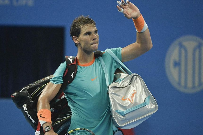 Rafael Nadal of Spain leaves the court after his defeat against Martin Klizan of Slovakia in their men's singles quarter final match at the China Open tennis tournament in the National Tennis Center of Beijing on Oct 3, 2014. -- PHOTO: AFP