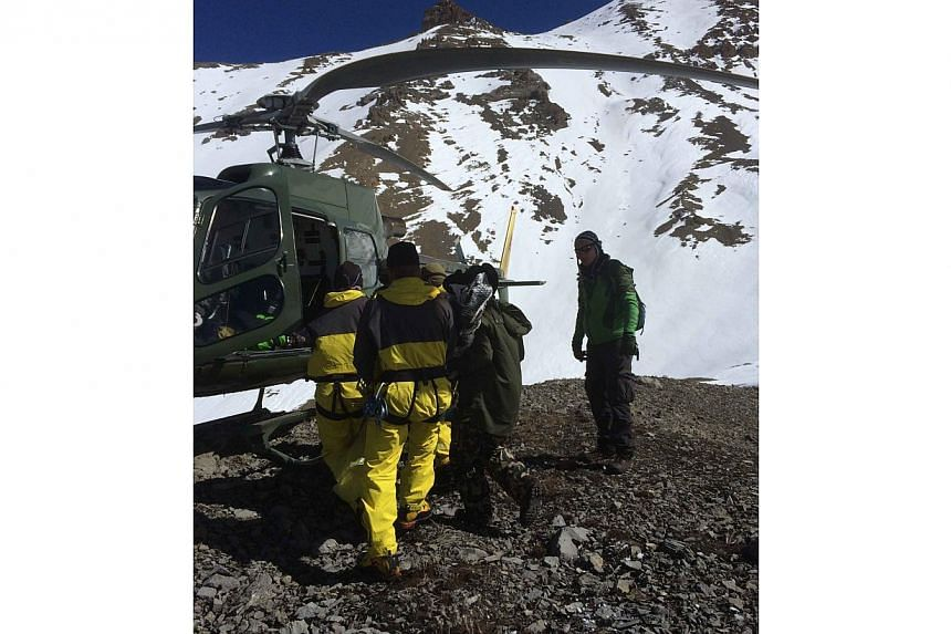 Nepal's Prime Minister has pledged to set up a weather warning system after a major Himalayan snowstorm killed 32 people at the height of the trekking season, 17 of them tourists. -- PHOTO: AFP