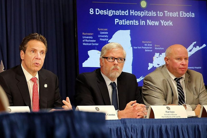 Governor Andrew Cuomo (left) speaks at a meeting with city representatives on New York's planned response to an Ebola case on Oct 16, 2014 in New York City. While there have been no cases of Ebola in New York as yet, the governor has designated eight