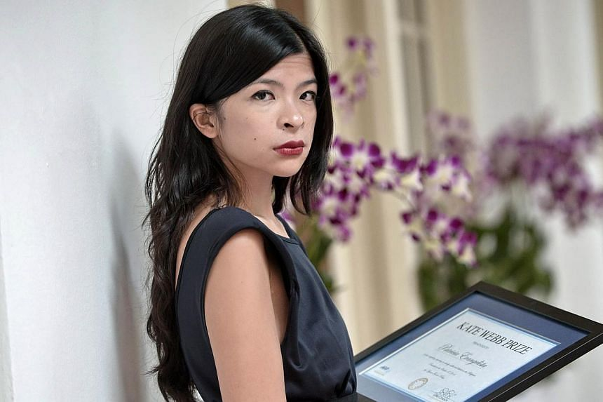 Multimedia journalist Patricia Evangelista received the 2014 Kate Webb Prize from Agence France-Presse on Friday for her compelling reporting on conflict and disaster in her native Philippines. -- PHOTO: AFP