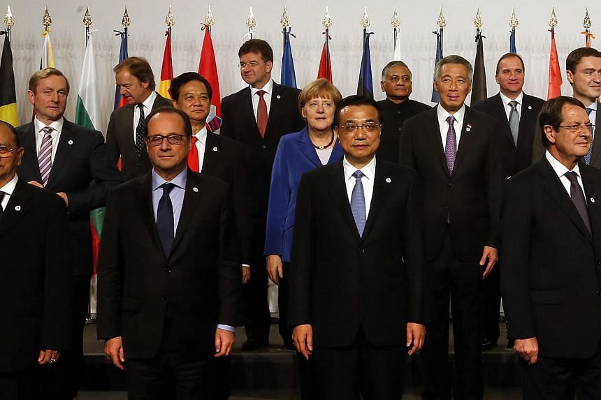 Prime Minister Lee Hsien Loong is flanked by German chancellor Angela Merkel and Estonian Prime Minister Taavi Roivas at theAsia-Europe Meetingsummit opening ceremony. In front of Mr Lee are Chinese premier Li Keqiang and European Commiss