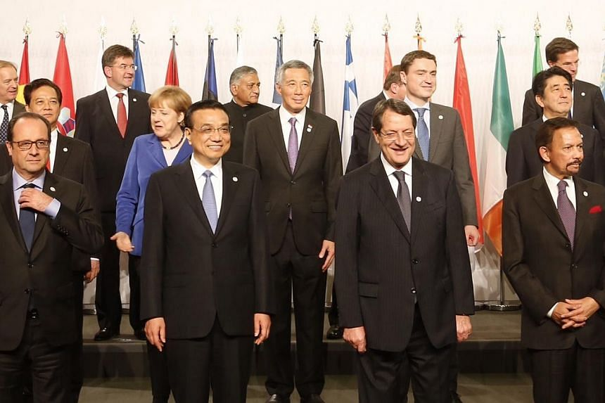 Prime Minister Lee Hsien Loong flanked by German chancellor Angela Merkel and Estonian Prime Minister Taavi Roivas at the ASEM summit opening ceremony. In front of Mr Lee are Chinese premier Li Keqiang and European Commission president Jose Manuel Ba