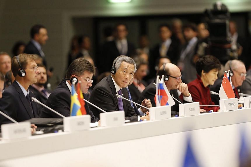 Prime Minister Lee Hsien Loong attending the 10th Asia-Europe Meeting (ASEM) on Oct 16, 2014 in Milan, Italy. -- PHOTO: CHEW SENG KIM