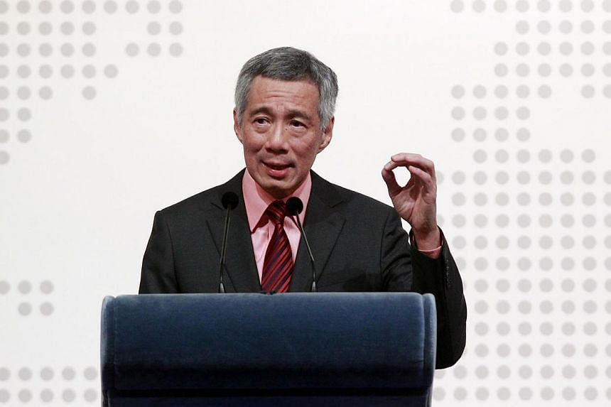 Singapore is seriously considering how it can be a helpful partner in the fight against the militant group Islamic State in Iraq and Syria (ISIS), Prime Minister Lee Hsien Loong told leaders from Asia and Europe on Friday. -- PHOTO: LIANHE ZAOBAO FIL