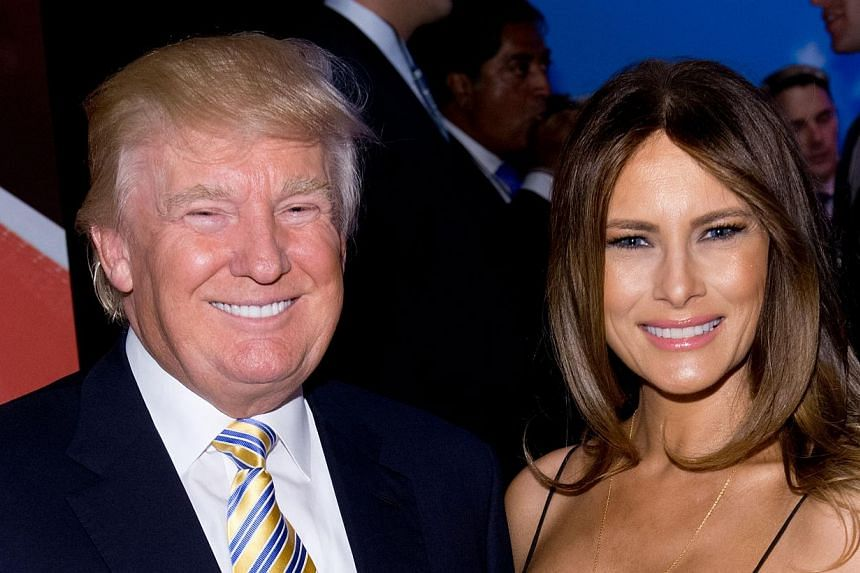 Donald Trump and Melania Trump attend the US Ryder Cup Captain's Picks News Conference on Sept 2, 2014 in New York City. Tycoon Donald Trump is personally liable for operating a for-profit investment school without the required licence, a New York ju